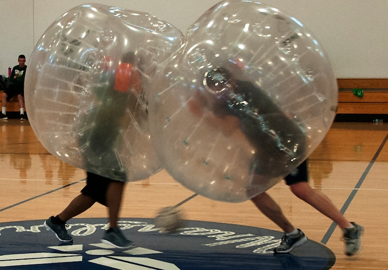 Two Airmen ram into one another during a bubble soccer game April 22, 2016, during a tournament inside the Freedom Hall Fitness Center on F.E. Warren Air Force Base, Wyo. Though scoring a goal was the overall objective, utilizing the bubbles to push opponents out of the way helped score. (U.S. Air Force photo by Senior Airman Brandon Valle)