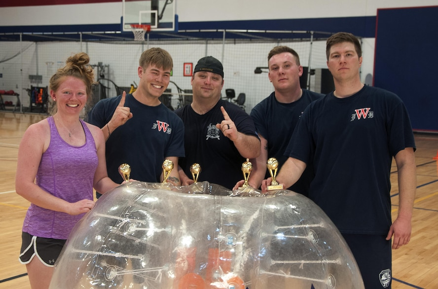 The team from the 90th Civil Engineer Squadron Fire Department pose after winning the championship of a bubble soccer tournament inside the Freedom Hall Fitness Center on F.E. Warren Air Force Base, Wyo., April 22, 2016. The team went undefeated through five games to claim victory. (U.S. Air Force photo by Senior Airman Brandon Valle)