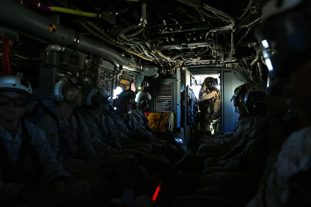 Marines with Headquarters and Headquarters Squadron, Marine Corps Air Station Camp Pendleton fly on an MV-22 Osprey to Red Beach, Camp Pendleton to start Warrior Night, April 22, 2016. The Warrior Night is a way for Marines in a unit to come together and enjoy each other's company to harden camaraderie and espirit de corps. (Marine Corps Photo by Lance Cpl. Emmanuel Necoechea)