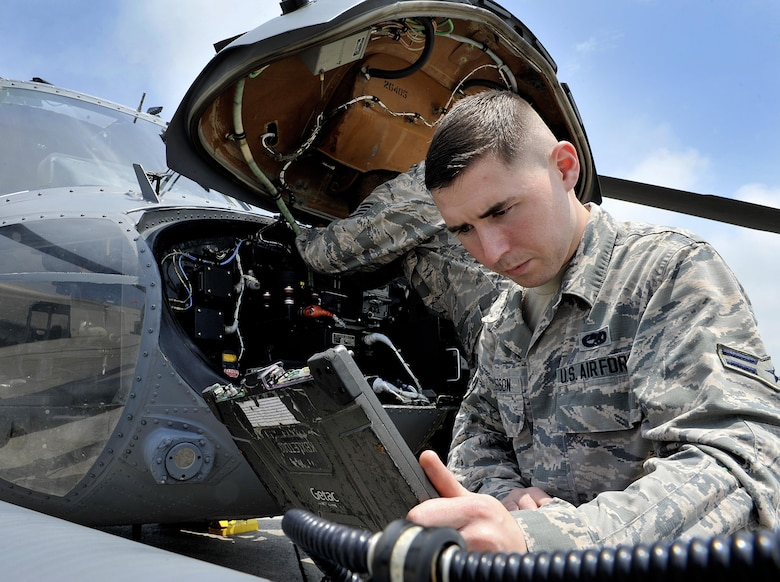 U.S. Air Force Airman 1st Class Ian Wilkerson, 718th Aircraft Maintenance Squadron communication navigation specialist, checks technical orders during a pre-flight inspection, April 26, 2016, at Kadena Air Base, Japan. The HH-60G Pave Hawk is maintained by Airmen with various specialties that include communications, navigations, engines, hydraulics, electronics, weapons systems and electronic counter warfare. (U.S. Air Force photo by Naoto Anazawa)