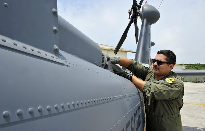 U.S. Air Force Senior Airman Ricardo Tinoco, 33rd Helicopter Maintenance Unit special mission aviator, inspects a tail shift of an HH-60G Pave Hawk helicopter during a pre-flight inspection, April 26, 2016, at Kadena Air Base, Japan. The preflight inspection consists of a thorough inspection of the entire aircraft to ensure its capability to perform the mission safely and effectively. (U.S. Air Force photo by Naoto Anazawa)