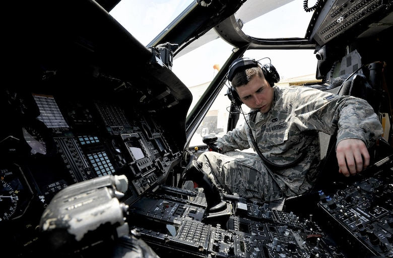 U.S. Air Force Airman 1st Class Ian Wilkerson, 718th Aircraft Maintenance Squadron communication navigation specialist, checks the radio systems of an HH-60G Pave Hawk helicopter during a pre-flight inspection, April 26, 2016, at Kadena Air Base, Japan. Maintenance and inspections are conducted before and after every mission to ensure aircraft safety and longevity. (U.S. Air Force photo by Naoto Anazawa)