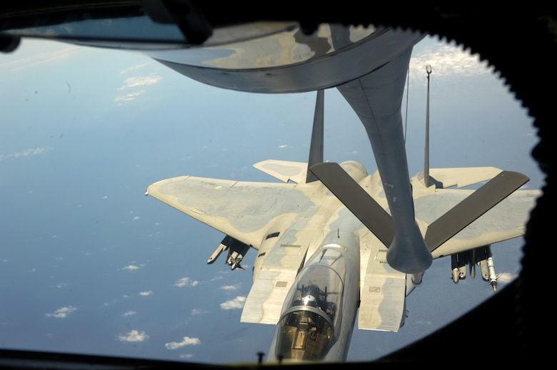 A U.S. Air Force KC-135 Stratotanker maneuvers into position above an F-15C Eagle during a refueling mission April 20, 2016, near Kadena Air Base, Japan. The 909th Air Refueling Squadron provides combat-ready KC-135 tanker aircrews to support peacetime operations and all levels of conflict in the Indo-Asia-Pacific theater. (U.S. Air Force photo by 1st Lt. Virginia Lang/Released)