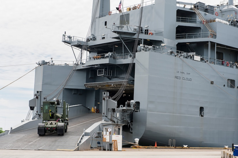 A truck is loaded aboard the U.S. Naval Ship Red Cloud, April 18, 2016, at Joint Base Charleston, S.C. – Weapons Station. Members from the Army Strategic Logistics Activity Charleston and the 841st Transportation Battalion staged, processed and configured 1,300 pieces of equipment to support  USNS Red Cloud's prepositioned ship mission. (U.S. Air Force photo/Staff Sgt. Jared Trimarchi)