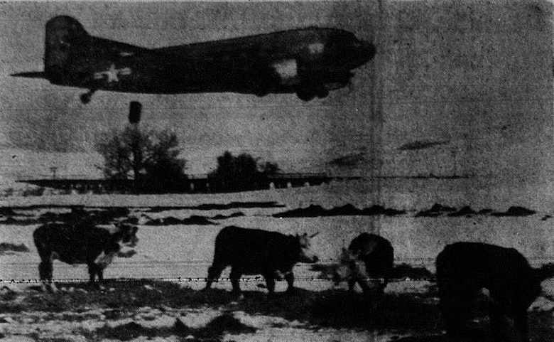 In the winter of 1948-1949, severe weather affected livestock and game all across the western United States.  Here, a USAF C-47 transport aircraft piloted by Capt. M. Peck drops a hay bale from low altitude to cattle on a ranch 12 miles northwest of Chadron, Nebraska, in another example of the peacetime application of airpower.  (Courtesy La Grande Observer, via Eastern Oregon University Library)