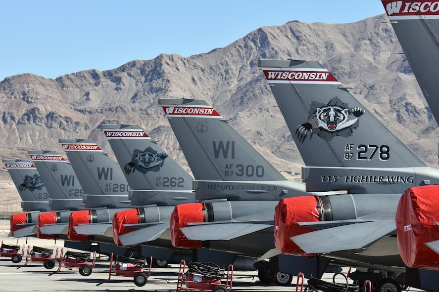 The distinctive tail markings of F-16 Fighting Falcons from the 115th Fighter Wing in Madison, Wis., adorn the aircraft ramp at Nellis Air Force Base, Nev., April 2, 2016. The Wisconsin Air National Guard unit deployed more than 100 Airmen and eight F-16 Fighting Falcons for two weeks to support advanced training in weapons and tactics employment at the United States Air Force Weapons School. (U.S. Air National Guard photo by Master Sgt. Paul Gorman/Released)