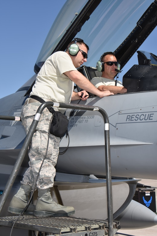 Technical sergeants Chad Boyd, left, and Douglas Linder, avionics systems specialists with the 115th Fighter Wing in Madison, Wis., perform avionics maintenance on an F-16 Fighting Falcon at Nellis Air Force Base, Nev., April 5, 2016. The Wisconsin Air National Guard unit deployed more than 100 Airmen and eight F-16 Fighting Falcons for two weeks to support advanced training in weapons and tactics employment at the United States Air Force Weapons School. (U.S. Air National Guard photo by Master Sgt. Paul Gorman/Released)