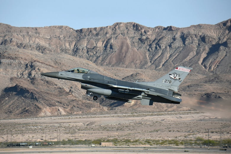 An F-16 Fighting Falcon with the 115th Fighter Wing in Madison, Wis., takes off on a training mission from Nellis Air Force Base, Nev., April 5, 2016. The Wisconsin Air National Guard unit deployed more than 100 Airmen and eight F-16 Fighting Falcons for two weeks to support advanced training in weapons and tactics employment at the United States Air Force Weapons School. (U.S. Air National Guard photo by Master Sgt. Paul Gorman/Released)