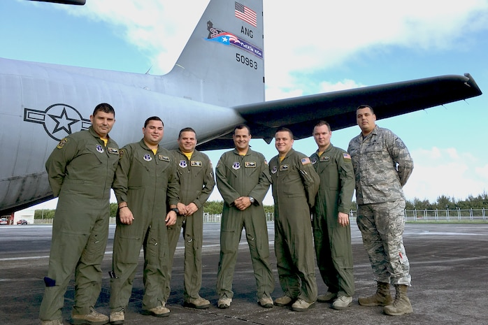 U.S. Air Force aircrew of the 156th Operations Group, Puerto Rico Air National Guard, receive recognition from Lt. Col. Tammy D. Pokorney, chief nurse of the 375th Aeromedical Evacuation Squadron, Scott Air Force Base, Illinois for excellent customer service and crew integrity during the PRANG's first east coast aeromedical evacuation mission on a WC-130 Hercules, April 2016.  The expeditious movement and professional teamwork of the PRANG aircrew with the 375th AE crew helped expedite the transportation of four patients to four separate locations ensuring mission effectiveness and success. (U.S. Air National Guard photo by Tech. Sgt. Jaime Torres-Urbina)