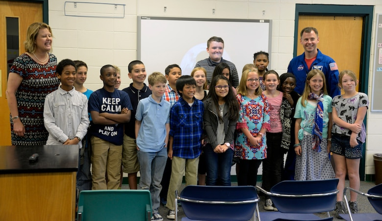 Kristine Karter's fifth grade class poses for a photo with Air Force Lt. Col. Tyler Hague, NASA astronaut, during his visit to Maxwell Elementary School, April 20, 2016. Students from Karter's class wrote letters to NASA asking to have the opportunity to speak to an actual astronaut. (U.S. Air Force photo/Senior Airman Tammie Ramsouer)