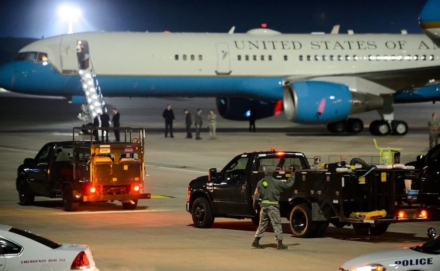 Airmen and their vehicles line the flightline to service Air Force one and support jet April 20, 2016, at Ramstein Air Base, Germany. The Department of Defense, working in conjunction with other interagency and European partners, provides resources to support the President of the United States' visit to the United Kingdom and Germany. The 86th Airlift Wing security forces, logistic readiness squadron and other units worked among 521st Air Mobility Operations Wing aerial porters and maintainers ensure a clean and ready aircraft. (U.S. Air Force photo/Staff Sgt. Armando A. Schwier-Morales)