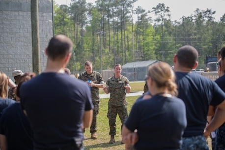 Navy Lt. Lani Kuhlow, a Health Service Augmentation Program instructor, debriefs sailors following a medical scenario at Camp Lejeune, N.C., April 20, 2016. Sailors with the Camp Lejeune Naval Hospital were put through a week-long HSAP training exercise, where they were required to familiarize themselves with the gear and operations of a shock trauma platoon in a deployed environment.