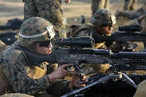 U.S. Marines with Black Sea Rotational Force fire M240B light machine guns during a live-fire exercise to confirm their zero aboard Mihail Kognalniceanu Air Base, Romania, Feb. 2, 2016. Marines from 1st Battalion, 8th Marine Regiment, conducted battle sight zeroes on various individual weapons systems, to prepare for future BSRF exercises and contingencies. (U.S. Marine Corps photo by Cpl. Kelly L. Street, 2D MARDIV COMCAM/Released)