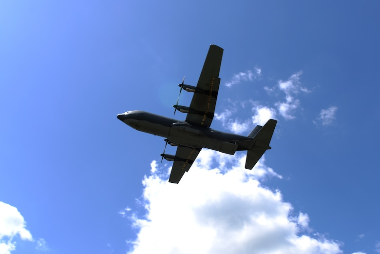 A Royal Australian Air Force C-130J flies above a drop zone April 22, 2016, near Ft. Polk, La. The Hercules dropped heliboxes, which contained supplies used by U.S. Air Force Airmen undergoing a survival, evasion, resistance and escape training exercise. (U.S. Air Force photo by Airman 1st Class Mercedes Taylor)