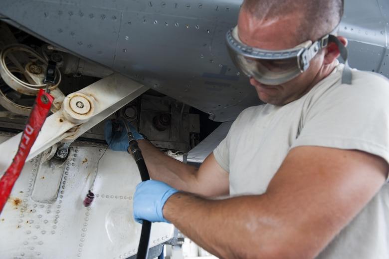 U.S. Air Force Senior Airman Devon Powell, 44th Aircraft Maintenance Unit dedicated crew chief, performs routine servicing on his F-15C Eagle, April 26, 2016, at Kadena Air Base Japan. As a dedicated crew chief Powell is assigned to an F-15C and is responsible for the day-to-day maintenance to ensure the fighter is ready at all times. (U.S. Air Force photo by Airman Zackary A. Henry)
