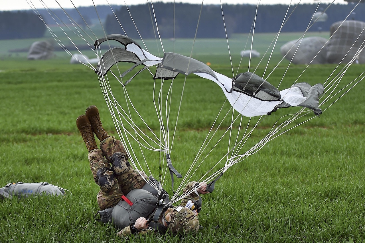 A paratrooper conducts a parachute landing fall during airborne operations as part of Exercise Saber Junction 16 near Grafenwoehr, Germany, April 12, 2016. Army photo by Gertrud Zach