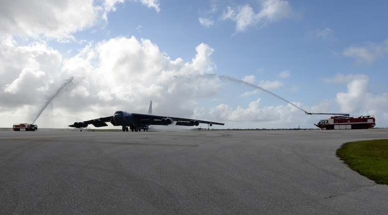 Fire trucks spray water on a B-52 Stratofortress piloted by Brig. Gen. Andrew Toth; 36th Wing commander; to celebrate his fini-flight April 26; 2016; at Andersen Air Force Base; Guam. Aircraft and pilots are traditionally doused with water to celebrate the aviator's flying career. (U.S. Air Force photo by Airman 1st Class Jacob Skovo)
