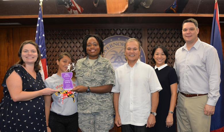 Senior Airman Ameka Mmoh, 36th Wing Public Affairs broadcast journalist, and her little sister Keiya pose stand for a photo while Mmoh accepts the 2016 Big Sister of the Year award from Big Brothers Big Sisters Guam Feb. 2, 2016, at the Governors Complex, Guam. Mmoh was given this award in appreciation for her outstanding service and dedication to her mentee, Keiya. (U.S. Air Force Photo/Capt. Joel Banjo-Johnson)