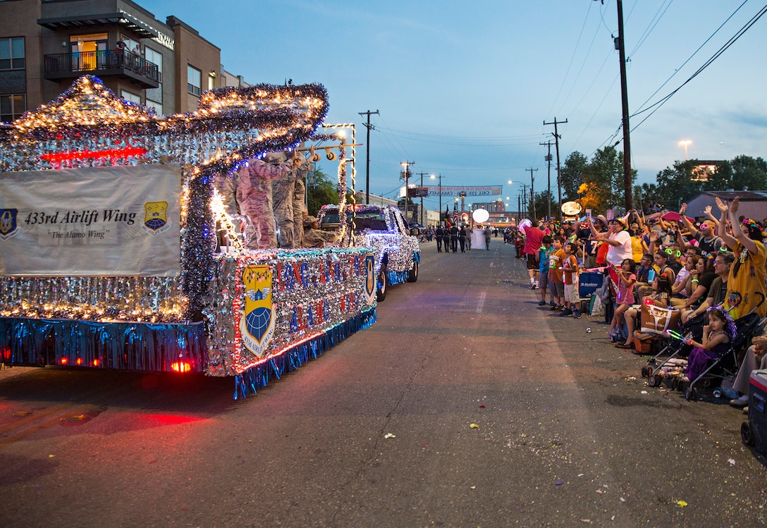 The 433rd Airlift Wing float travels down the Fiesta Flambeau parade route April 23, 2016. The Fiesta Flambeau parade is one of the largest illuminated parades in the world, with over 750,000 spectators and 1.5 million television viewers. (U.S. Air Force photo by Benjamin Faske) (released)