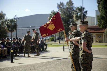 A Marine with Combat Logistics Battalion 2, stands at parade rest with the Battalion's guidon during the transfer of authority ceremony on April 25, 2016, at Naval Air Station Sigonella, Italy.  Lt. Col. Matthew Hakola, the Commanding Officer for CLB-6, transferred authority of Special Purpose Marine Air-Ground Task Force Crisis Response-Africa Logistics Combat Element to Lt. Col. Randall Jones, the Commanding Officer of CLB-2. (U.S. Marine Corps photo by Cpl. Alexander Mitchell/released)