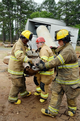 Firefighters from various fire departments throughout the area rescue a simulated injured victim during Exercise Black Swan 2016 aboard Marine Corps Logistics Base Albany, April 12.