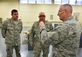Commander of the 932nd Airlift Wing, Col. Jonathan Philebaum, discusses maintenance issues with Command Chief Master Sgt. Chad Welch (left) and the supervisor of the 932nd Metal Technology Shop, Master Sgt. Glenn Greene (center).  Colonel Philebaum took several days recently to make the rounds and meet people throughout the Illinois unit at Scott Air Force Base, which is part of 22nd Air Force, Air Force Reserve Command.  (U.S. Air Force photo by Tech. Sgt. Christopher Parr)
