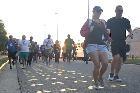 Educators from the greater Baton Rouge area run to the yellow footprints aboard Marine Corps Recruit Depot Parris Island, S.C., April 27, 2016. The teachers, coaches, and principals of Recruiting Stations Baton Rouge and Nashville participate in a three-day workshop designed to inform educators about military service and life in the Marine Corps. (Official Marine Corps photo Cpl. John-Paul Imbody)