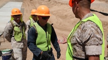U.S. Marine Col. Ladaniel Dayzie presents a Marine from 7th Engineer Support Battalion with a challenge coin in El Centro, California, April 19, 2016. Dayzie is the deputy commander of Joint Task Force North in El Centro. Marines with 7th ESB assisted in a road improvement project with JTF-N during the months of March and April. During the project, the Marines have been processing and leveling dirt to improve the road's quality as well as constructing low-water crossings to maintain the integrity of the road during wet conditions.