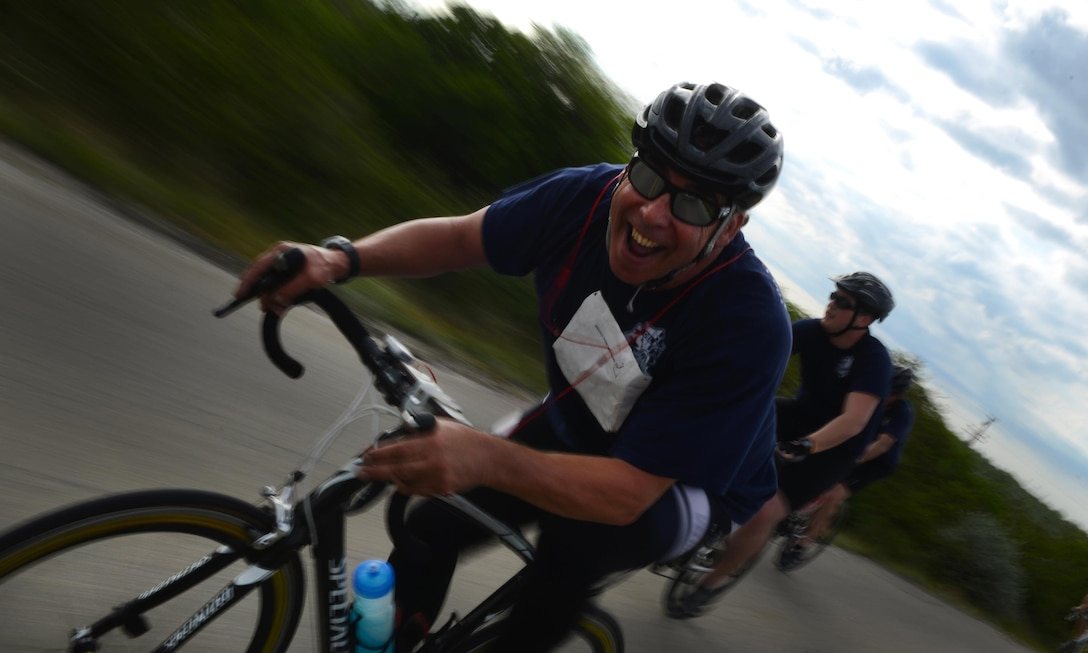 A competitor smiles as he bikes during the Adventure Race XII in Del Rio, Texas, April 23, 2016. The biking portion of the Adventure Race stretches 23 miles from Laughlin Air Force Base to the Laughlin Southwinds Marina off of Lake Amistad. (U.S. Air Force photo by Senior Airman Ariel D. Partlow)