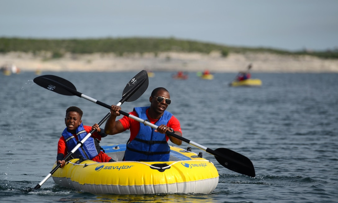 Maj. Willie Allen, front, 434th Flying Training Squadron director of operations, and his son David Allen, paddle in a raft during the 12th annual Adventure Race at the Laughlin Southwinds Marina near Del Rio, Texas, April 23, 2016. Nearly 200 people from Val Verde County and surrounding cities participated in the Adventure Race, which included up to a 4-mile run with mystery challenges, a 23-mile bicycle ride and a mile-long water rafting portion. (U.S. Air Force photo by Senior Airman Ariel D. Partlow)