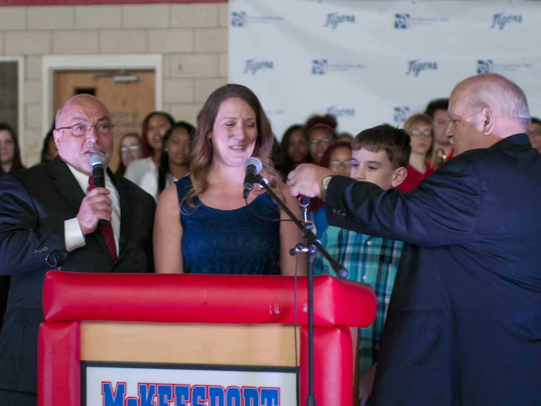 John Bertoty, of Blue Roof Technologies, hand keys to Staff Sgt. Michelle Satterfield, with the 14th Quartermaster Detachment, for her new house during the ceremony for her in McKeesport, Pa., April 25, 2016. Satterfield is receiving a house built by the students of the McKeesport Area High School and Stephen Siller Tunnel to Towers Foundation for all of the volunteer work she has done in the past years. (U.S. Army photo by Staff Sgt. Dalton Smith / Released)