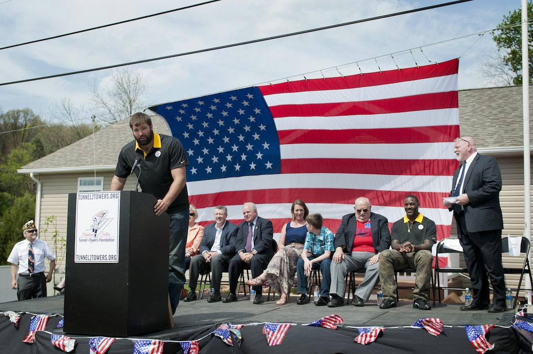 Alejandro Villanueva, Pittsburgh Steelers offensive tackle and former U.S. Army Ranger, talks about how the Steelers have supported the building of the house for Staff Sgt. Michelle Satterfield, with the 14th Quartermaster Detachment, during her ceremony in McKeesport, Pa., April 25, 2016. Satterfield is receiving a house built by the students of the McKeesport Area High School and Stephen Siller Tunnel to Towers Foundation for all of the volunteer work she has done in the past years. (U.S. Army photo by Staff Sgt. Dalton Smith / Released)