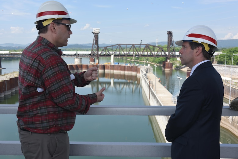 Tommy Long, U.S. Army Corps of Engineers Nashville District resident engineer, briefs Congressman Chuck Fleischmann, Tennessee District 3, while overlooking the coffer dam where construction of a new lock has resumed during a visit to the project in Chattanooga, Tenn., April 25, 2016.