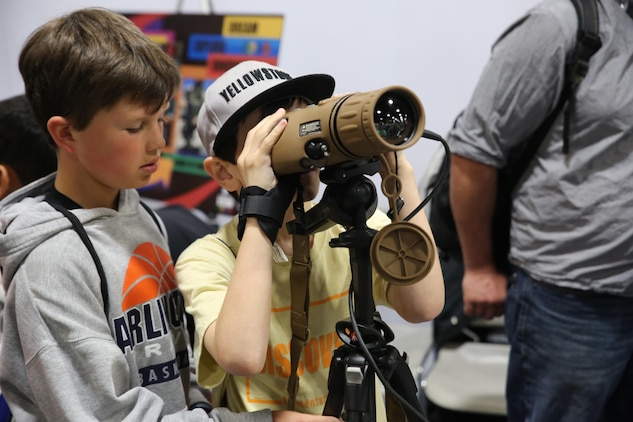A child looks through the Medium Range Thermal Bi-ocular during the USA Science & Engineering Festival April 14–17 in Washington, DC. The MRTB was one of the items Marine Corps Systems Command showcased at its exhibit booth. This year marked MCSC's second year participating in the festival as part of an ongoing effort to partner with other government agencies, academic institutions and private industry to improve STEM education in the United States.  (U.S. Marine Corps photo by Mathuel Browne)