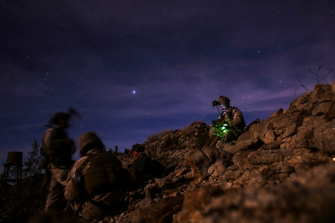 Marines set up communication during a night raid exercise at landing zone Dodo near Yuma, Ariz., April 21, 2016. Marine Corps photo by Lance Cpl. Zachary M. Ford