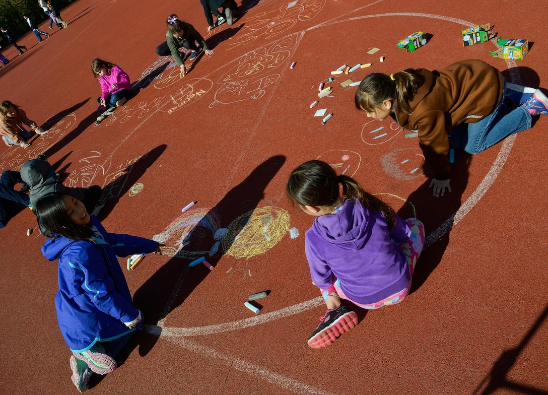 Children from Vogelweh Elementary School draw out their emotions during a therapy session April 21, 2016, at Vogelweh Air Base, Germany. Dozens of families recently separated from service members in Turkey and now live in the Kaiserslautern military community. (U.S. Air force photo/Airman 1st Class Lane T. Plummer)