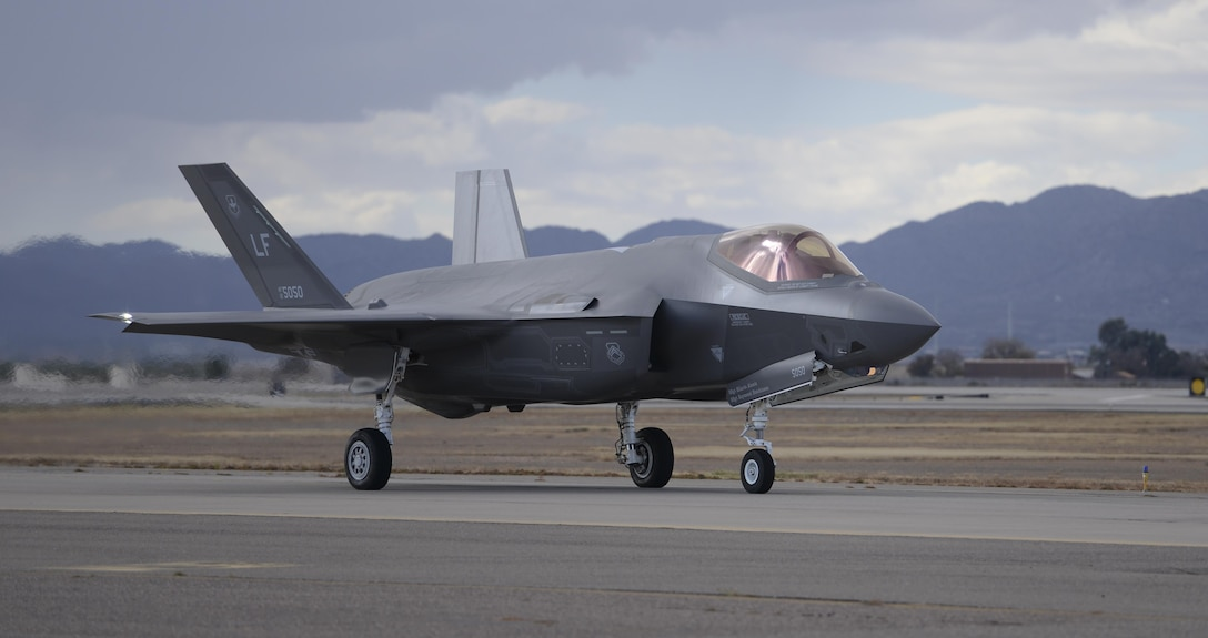 An F-35A Lightning II taxies from the runway onto the flightline after successfully completing a sortie Dec. 14, 2015, at Luke Air Force Base, Ariz. The F-35 is being adopted internationally by eight partner nations, including Norway, Italy and Australia. (U.S. Air Force photo/Airman 1st Class Ridge Shan)