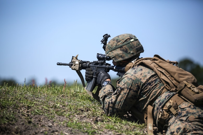Lance Cpl. Michael A. Rosales, a machine gunner with Kilo Company, 3rd Battalion, 8th Marine Regiment, engages targets down range during a fire team attack exercise as part of the battalion field exercise at Camp Lejeune, N.C., April 26, 2016. The FEX, now in its final week of operations, previously tested Marines on basic infantry fundamentals such as patrolling and land navigation. (U.S. Marine Corps photo by Cpl. Paul S. Martinez/Released)