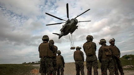 Marines conduct a helicopter support team exercise at Marine Corps Air Station Futenma, Okinawa, Japan, April 22, 2016. The Marines are landing support specialists, commonly referred to as red patchers, with Landing Support Detachment, 3rd Transportation Support Battalion, Combat Logistics Regiment 3, 3rd Marine Logistics Group, III Marine Expeditionary Force.