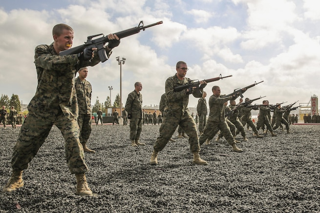 Recruits conduct straight thrusts during a Marine Corps Martial Arts Program Test at Marine Corps Recruit Depot San Diego, April 27, 2016. Twenty recruits at a time took the test as instructors evaluated them on hand-to-hand combat techniques, and various movements with knives and rifles. The recruits are assigned to  Charlie Company, 1st Recruit Training Battalion. Marine Corps photo by Lance Cpl. Angelica Annastas