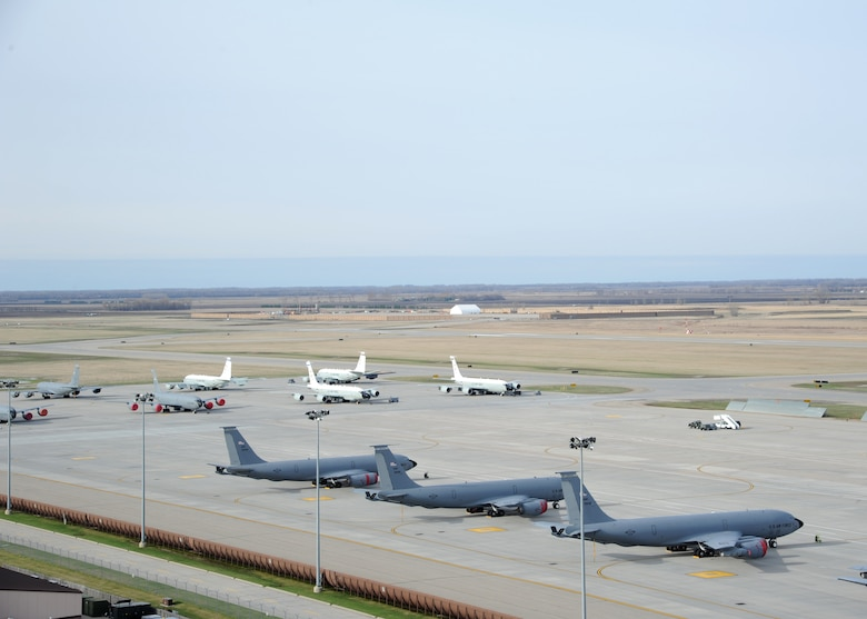 Several aircraft sit on the flight line April 27, 2016, on Grand Forks Air Force Base, N.D. The aircraft from Offutt Air Force Base, Neb., and McConnell Air Force Base, Kan., traveled to Grand Forks AFB to escape severe weather warnings at their bases. (U.S. Air Force photo by Airman 1st Class Ryan Sparks/Released)