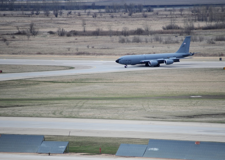 A KC-135 Stratotanker taxis down the flight line April 26, 2016, on Grand Forks Air Force Base, N.D. The aircraft was one of the first of several aircraft that traveled to Grand Forks AFB to escape severe weather warnings at their home stations. (U.S. Air Force photo by Staff Sgt. Desiree Economides/Released)