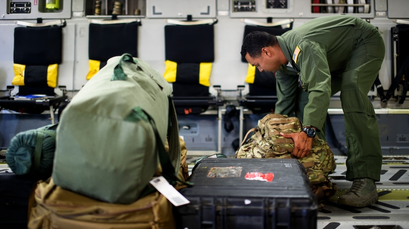 Staff Sgt. Luis Diaz, 15th Airlift Squadron loadmaster, straps down luggage and cargo April 25, 2016, on a C-17 Globemaster III at Joint Base Charleston – Air Base, S.C. The 437th Airlift Wing flew into Manta, Ecuador, in support of earthquake relief operations. Aboard the aircraft were Army personnel from the Contingency Response Group as well as equipment including a mobile control tower and a five-passenger vehicle. The 437th AW provides global reach airlift capability at anytime and anywhere in the world. Whenever natural disasters occur, the 437th AW can provide humanitarian aid in a moment's notice. (U.S. Air Force photo/Senior Airman Clayton Cupit)