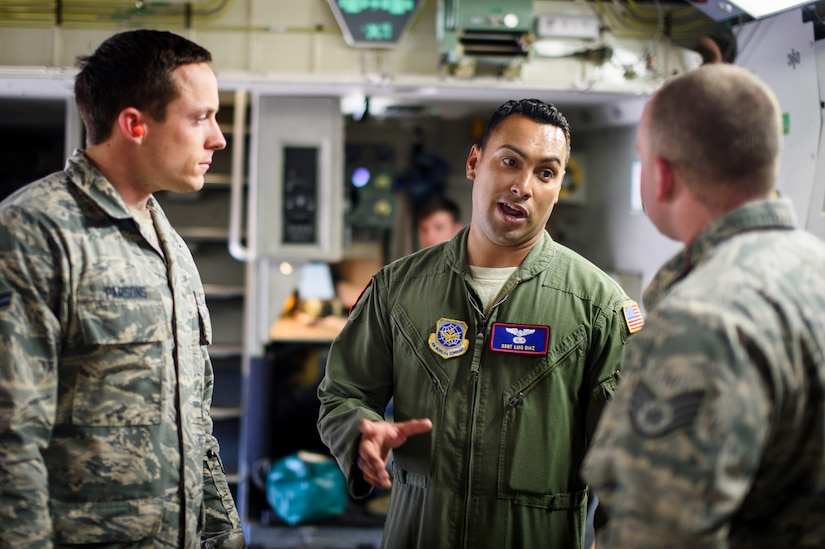 Staff Sgt. Luis Diaz, 15th Airlift Squadron loadmaster, briefs Airmen from the 1st Combat Camera Squadron about mission details April 25, 2016, on a C-17 Globemaster III at Joint Base Charleston – Air Base, S.C. The 437th Airlift Wing flew into Manta, Ecuador, in support of earthquake relief operations. Aboard the aircraft were Army personnel from the Contingency Response Group as well as equipment including a mobile control tower and a five-passenger vehicle. The 437th AW provides global reach airlift capability at any time to anywhere in the world. Whenever natural disasters occur, the 437th AW can provide humanitarian aid in a moment's notice. (U.S. Air Force photo/Senior Airman Clayton Cupit)