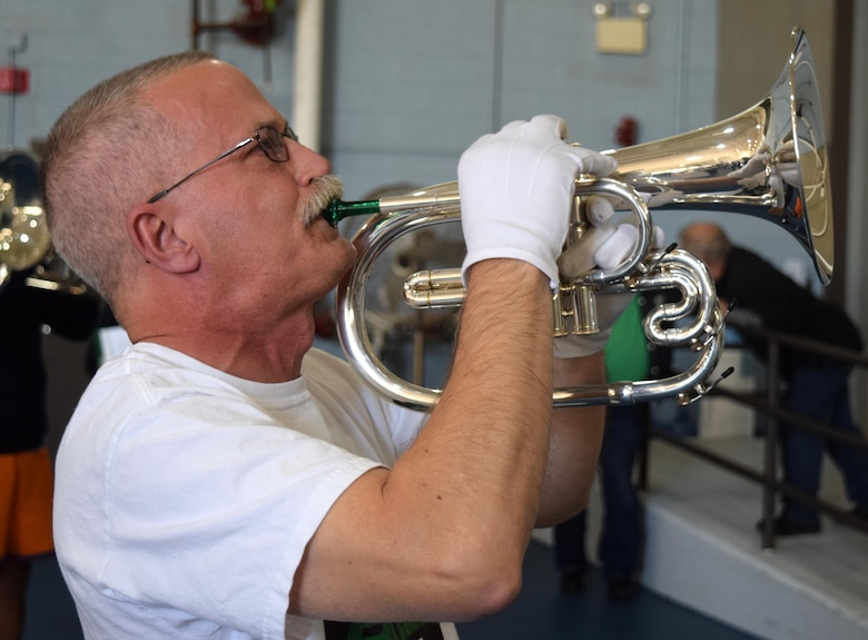 Lancers Alumni Drum and Bugle Corps' Tom Ackman, solos as a Mellophone player during a unique practice session the 80 member band experienced at the Horsham Air Guard Station in Horsham Pa. on April 23. Hosted by the 111ATKW, the Hanover, Pa. band stopped on route to practice in one of the base's former fighter aircraft hangars before a scheduled performance in Burlington, N.J. later that evening. (U.S. Air National Guard photo by Master Sgt. Christopher Botzum)