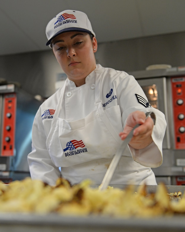 U.S. Air Force Senior Airman Jordyn R. Descoteaux, 157th Force Support Squadron Sustainment Services Flight services journeyman, prepares food during the unit training assembly, April 2, 2016, Pease Air National Guard Base, N.H. (U.S. Air National Guard photo by Staff Sgt. Curtis J. Lenz)
