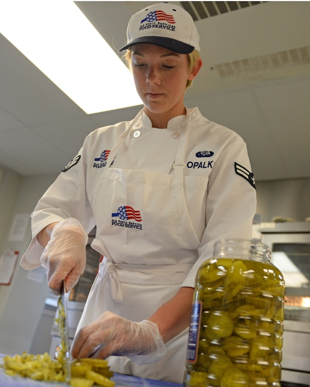 U.S. Air Force Airman 1st Class Melissa E. Opalka, 157th Force Support Squadron Sustainment Services Flight, prepares food during the unit training assembly, April 2, 2016, Pease Air National Guard Base, N.H. (U.S. Air National Guard photo by Staff Sgt. Curtis J. Lenz)