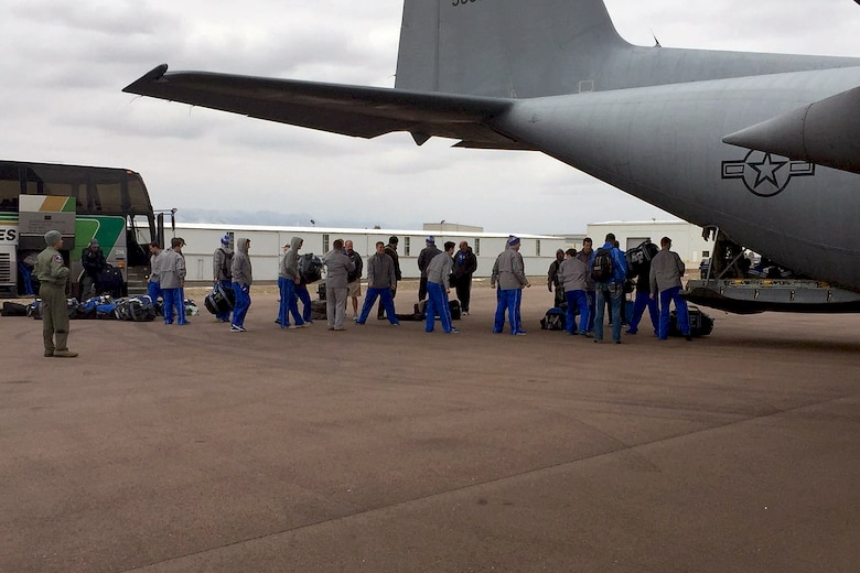 U.S. airmen of the 156th Operations Group, Puerto Rico Air National Guard, provide airlift transport on a WC-130 Hercules aircraft to the U.S. Air Force Academy ice hockey team from Rochester, N.Y. to Colorado Springs, Colo., Mar 19. As a unified team, the PRANG aircrew along with 47 Air Force Falcons team players and team personnel jointly loaded 3,000 pounds of hockey team equipment on the WC-130 for their 4 hours and 25 minutes flight to Colorado Spring. (U.S. Air National Guard photo by Maj. Luis Martinez)