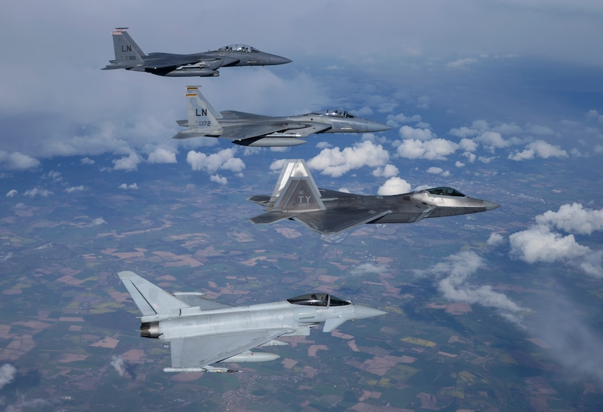 A four-ship formation consisting of a U.S. Air Force F-15E Strike Eagle from the 494th Fighter Squadron, an F-15 Eagle from the 493rd Fighter Squadron, an F-22A from the 95th Fighter Squadron, and a Royal Air Force Typhoon fly together during a training sortie April 26, 2016. 95th FS Airmen and aircraft are deployed from Tyndall Air Force Base, Fla., and will be conducting air training exercises with other U.S. and Royal Air Force aircraft over the next several weeks. (Courtesy photo by Jim Haseltine/Released)