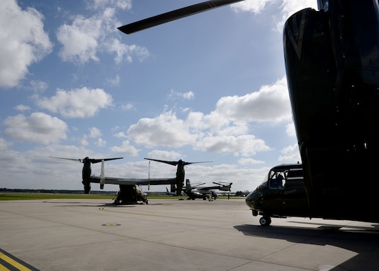 Three U.S. Marine Corps MV-22 Ospreys sit on the flightline April 19, 2016, on RAF Mildenhall, England. The multi-mission, tilt-rotor military aircraft, based out of Quantico, Va., were at RAF Mildenhall in support of the President's visit to the United Kingdom for bilateral meetings and to the Hannover Messe being held in Germany. U.S. European Command and US Air Forces in Europe-Air Forces Africa were working with other government agencies in the U.K. and Germany to provide assistance as requested, to ensure a successful visit.  (U.S. Air Force photo by Karen Abeyasekere/Released)